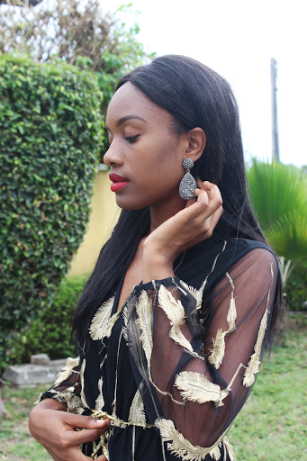 black girl with red lipstick and cute earrings