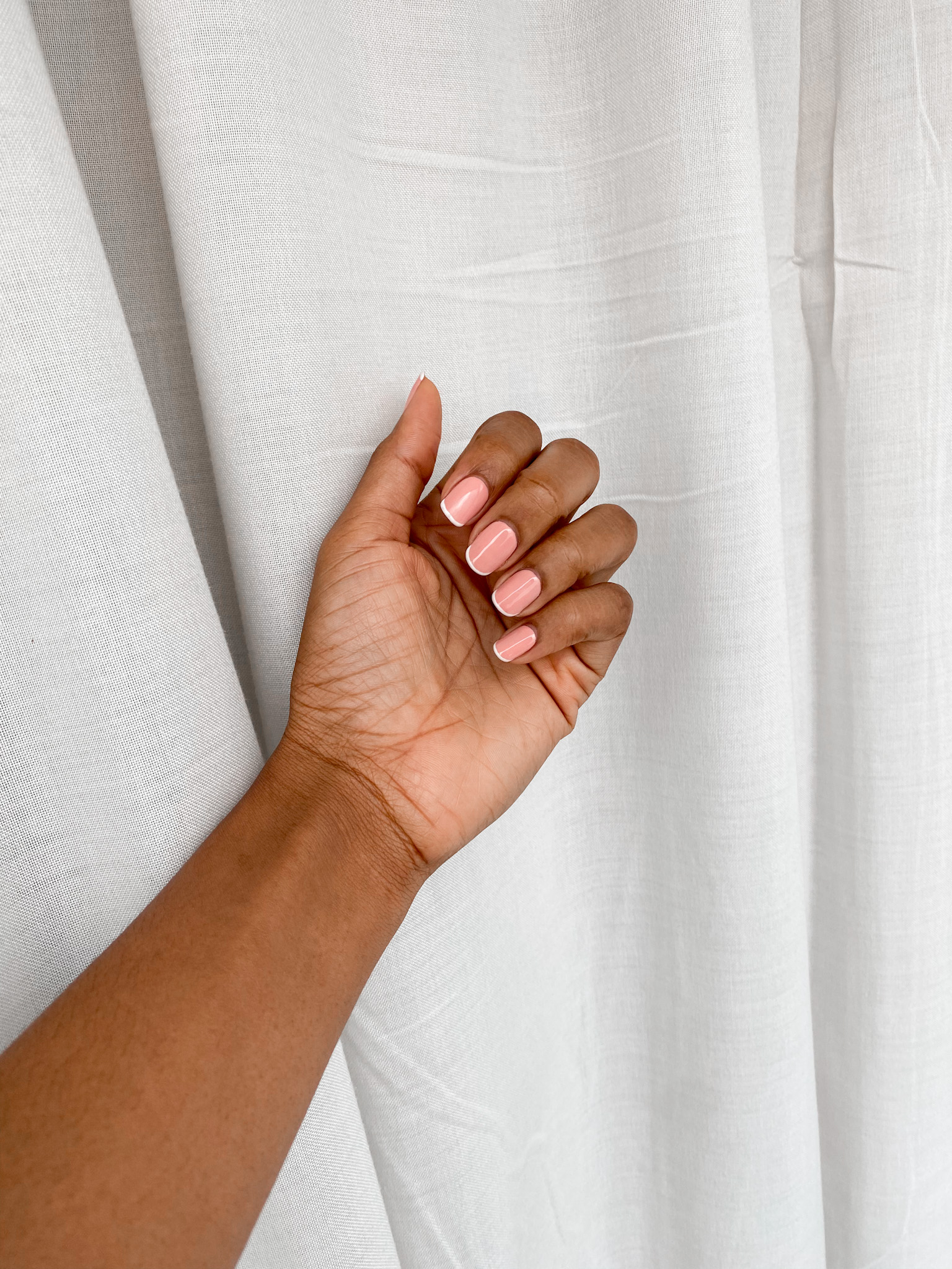 simple french manicure on dark skin